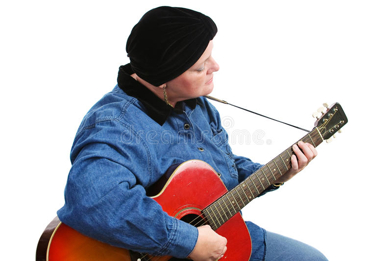 Superviviente del cáncer que toca la guitarra foto de archivo libre de regalías