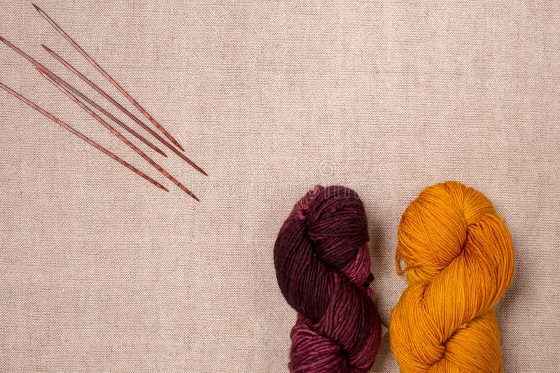 Superwash merino wool yarn on canvas background with space for text royalty free stock image