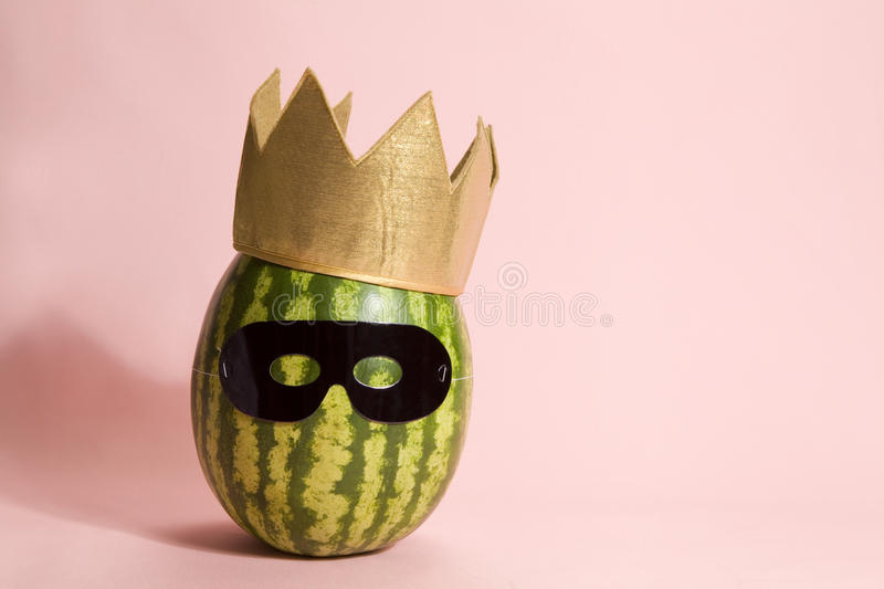 Superwatermelon wearing a black mask royalty free stock photography