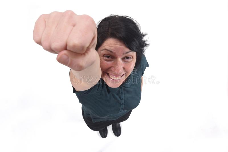 Superwoman avec son poing comme si elle volaient photos libres de droits