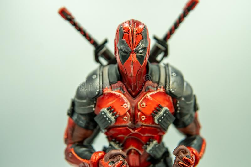 SUPHANBURI, THAILAND - june 9, 2019: Closeup Angry Deadpool model on white background.  royalty free stock photography