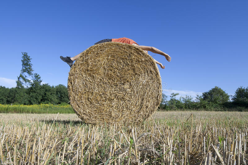 Download Supine Man On Hay Bale Royalty Free Stock Images - Image: 25859109
