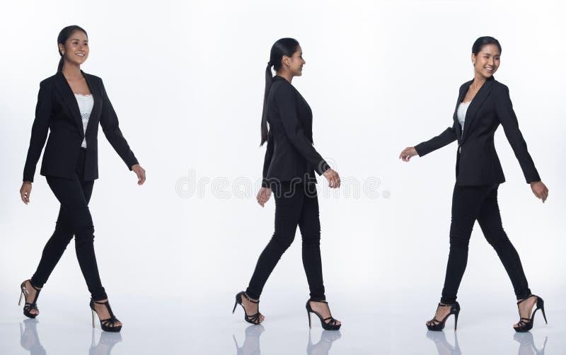 Suporte asiático da mulher de negócio no terno formal preto foto de stock royalty free
