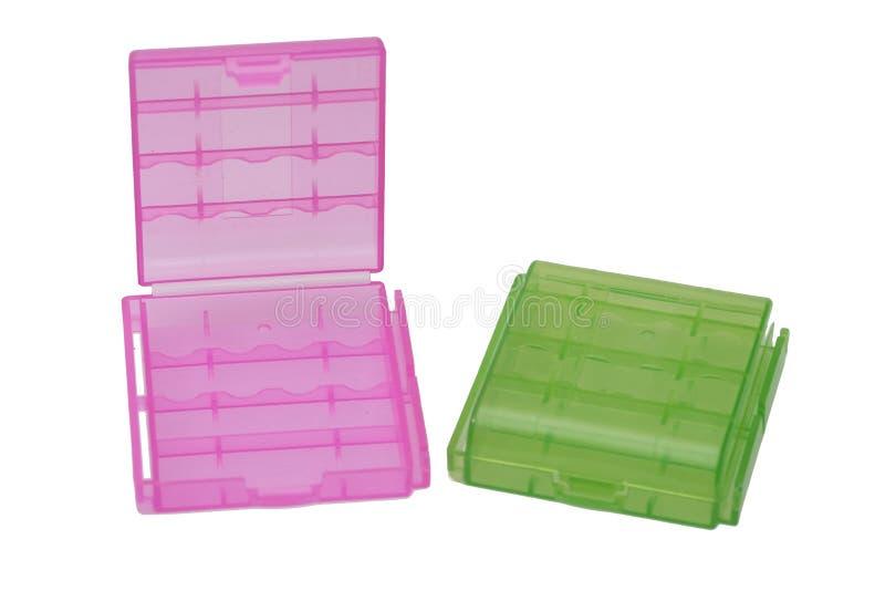 Suporte da bateria de dois plásticos no branco imagens de stock