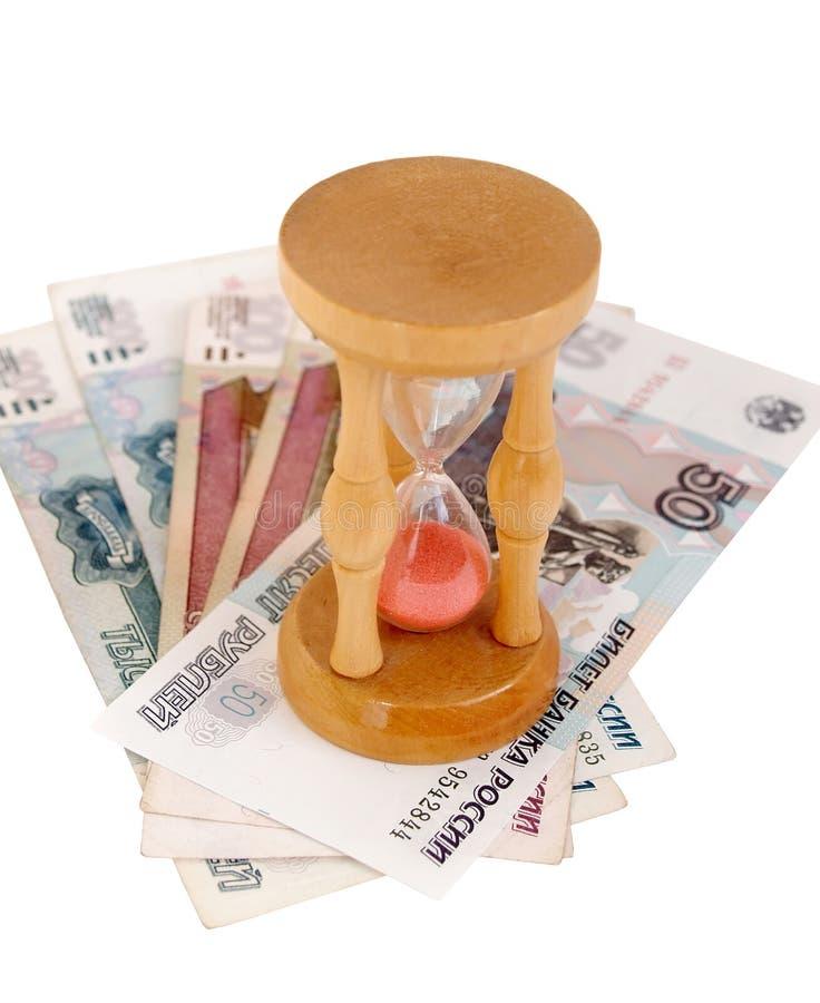 Suporte das ampulhetas no dinheiro Tempo é dinheiro fotos de stock royalty free