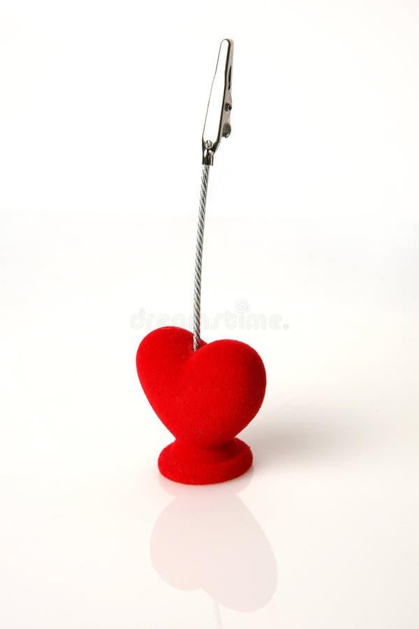 Suporte de cartão dado forma coração. fotografia de stock
