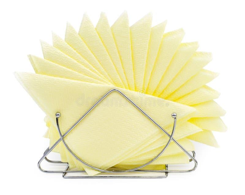 Suporte do guardanapo de tabela com os guardanapo amarelos isolados fotos de stock royalty free