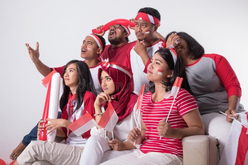 Suporte indonésio triste para perder o fósforo fotografia de stock