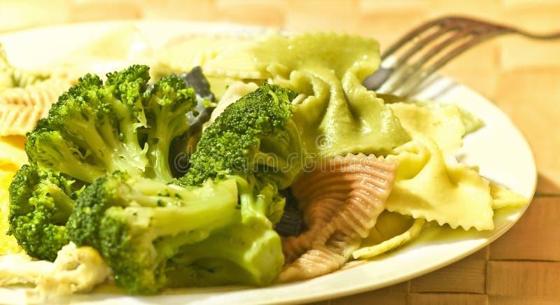 Supper. Boiled broccoli with pasta, closeup stock photos