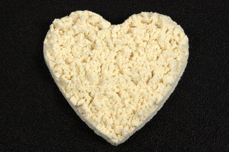 Supplément de protéine de forme de coeur photo stock