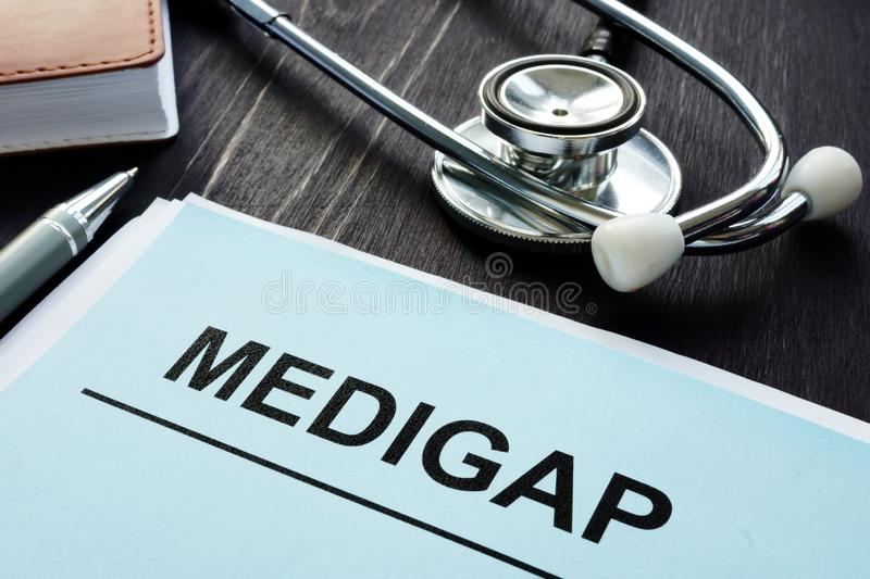 Medigap Supplement Health Insurance papers royalty free stock photography