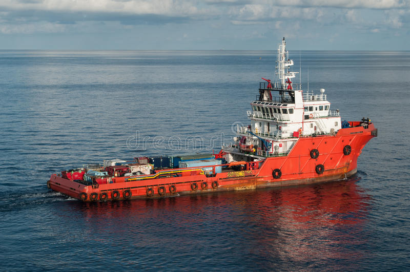 Supply boat around offshore rig stock image