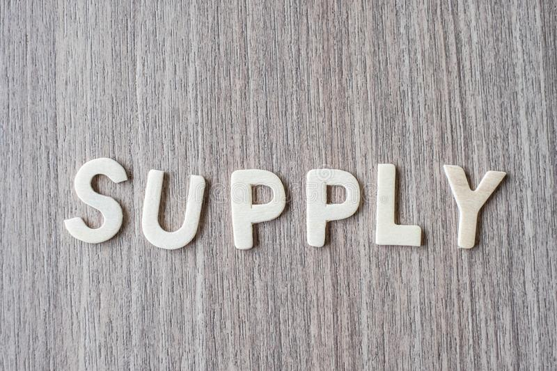 SUPPLY word of wooden alphabet letters. Business and Idea. Concept stock photo
