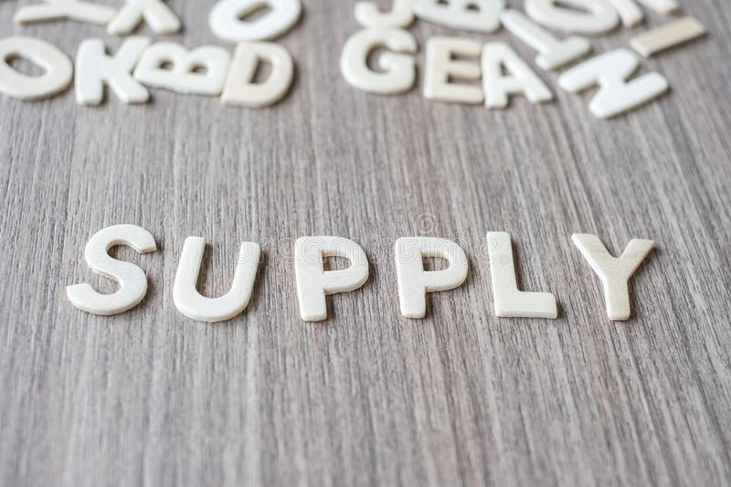 SUPPLY word of wooden alphabet letters. Business and Idea. Concept royalty free stock image