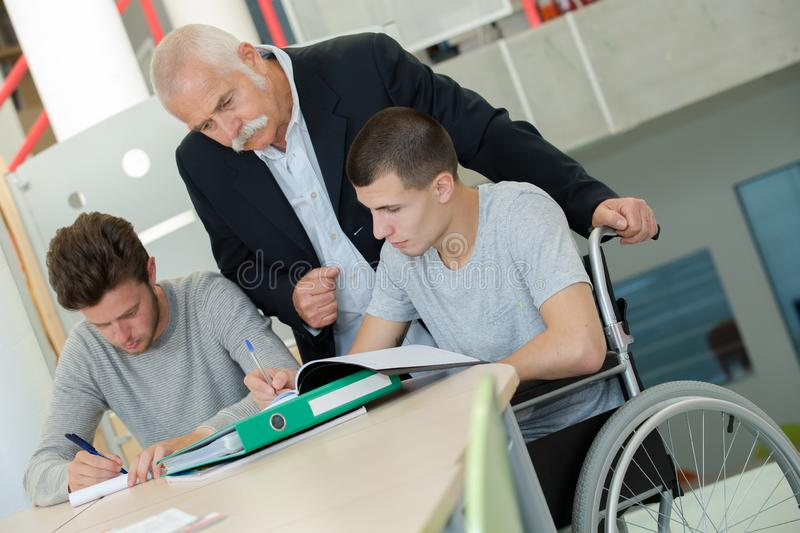 Support class for student on wheelchair. Wheelchair royalty free stock images