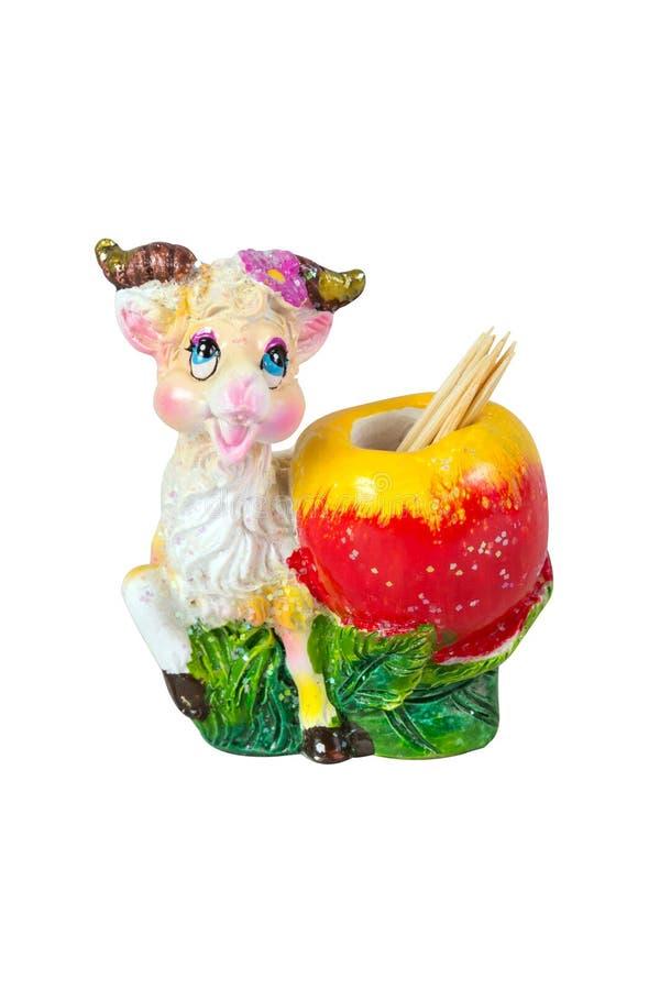 Support décoratif de souvenir de chèvre pour des cure-dents d'isolement sur le blanc photographie stock