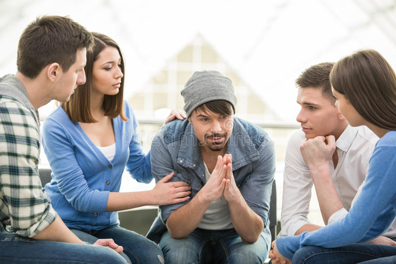 Support Group. Circle of trust. Group of people are sitting in circle and supporting each other stock image