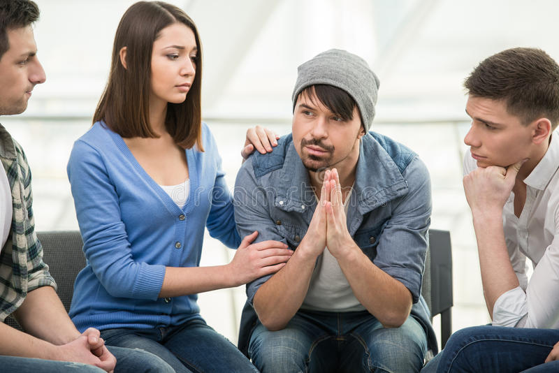 Support Group. Circle of trust. Group of people are sitting in circle and supporting each other royalty free stock photography