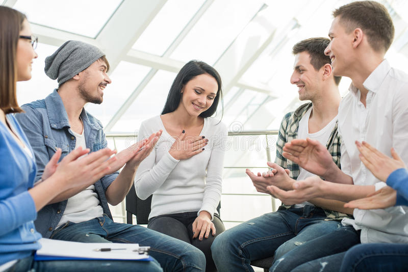 Support Group. Circle of trust. Group of people are sitting in circle and supporting each other stock photos