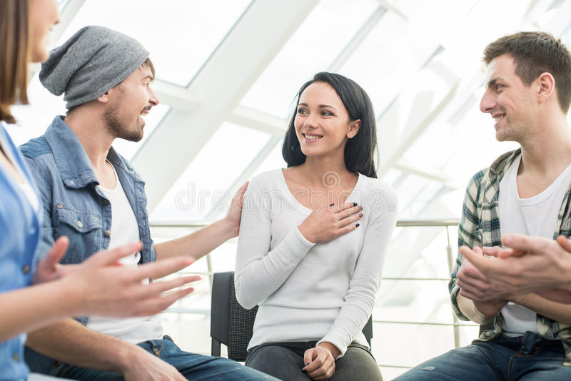 Support Group. Circle of trust. Group of people are sitting in circle and supporting each other stock photography