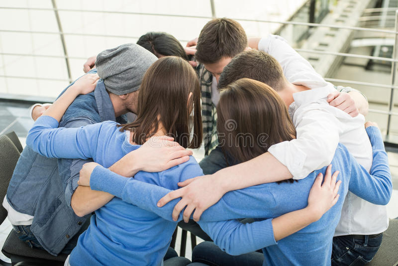 Support Group. Circle of trust. Group of people are sitting embracing in circle and supporting each other royalty free stock image