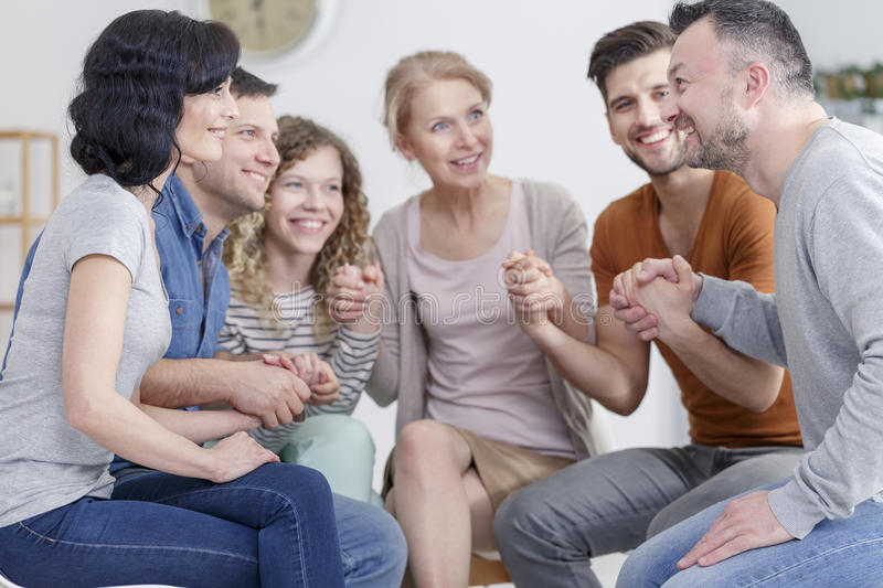 Support group praying. Small support group praying together after session royalty free stock image