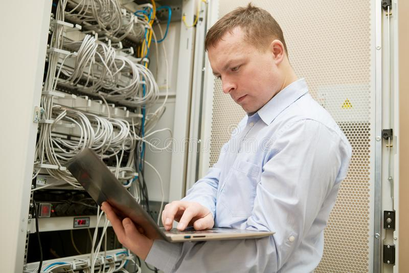 Support network service engineer with server computer equipment. Technical support. network service engineer or administrator work with server computer equipment royalty free stock image