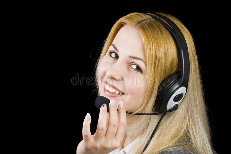 Support operator. Business customer support operator woman smiling - isolated in black royalty free stock images