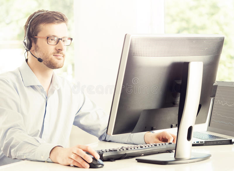 Support operator at work in a call center stock image
