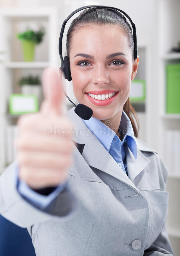 Support phone operator in headset at workplace. Business, communication, technology and call center concept - friendly female helpline operator with headphones royalty free stock photography