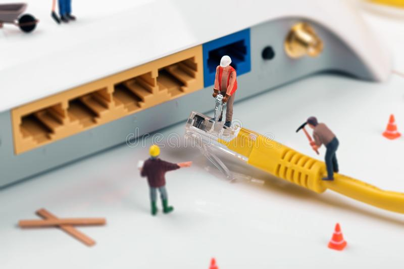 It support services. workers repairing internet connection stock images