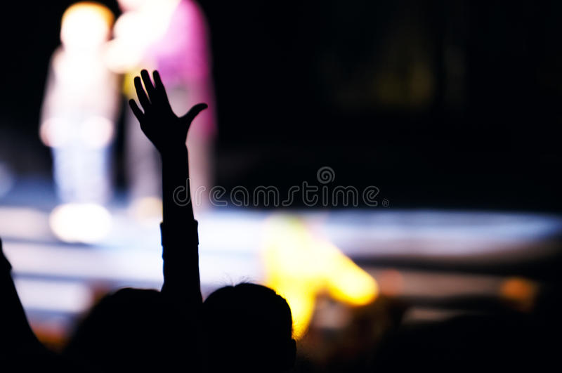 Supporter in the audience raising a hand royalty free stock photography