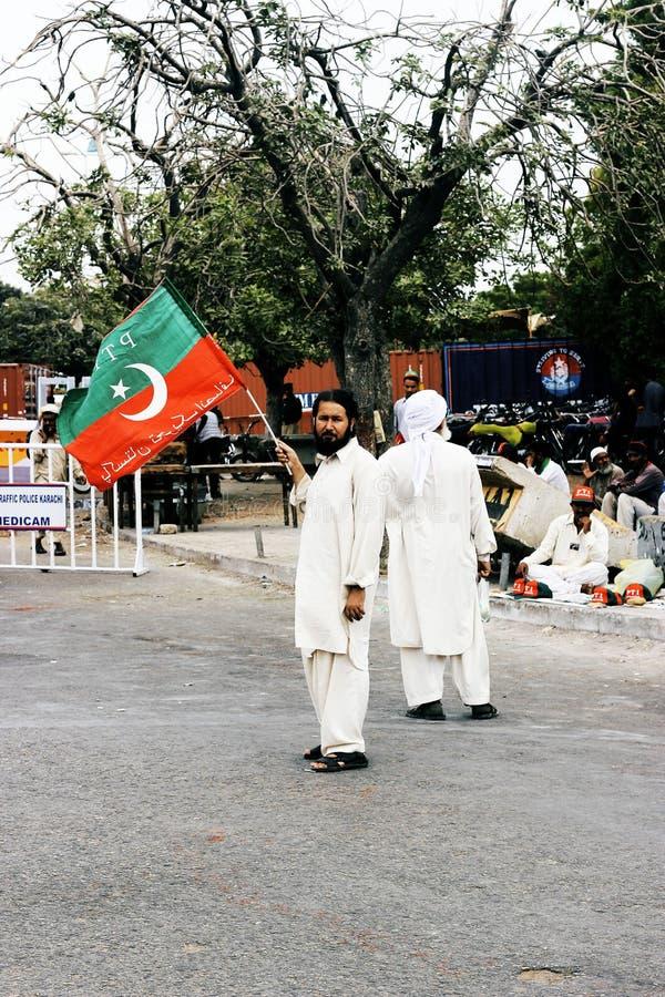 Supporter holding flag of Tehreek-e-Insaf. KARACHI, PAKISTAN - 21/09/2014 Tehreek-e-Insaf PTI Chairman, Imran Khan addresses to public meeting Mazar-e-quaid royalty free stock image