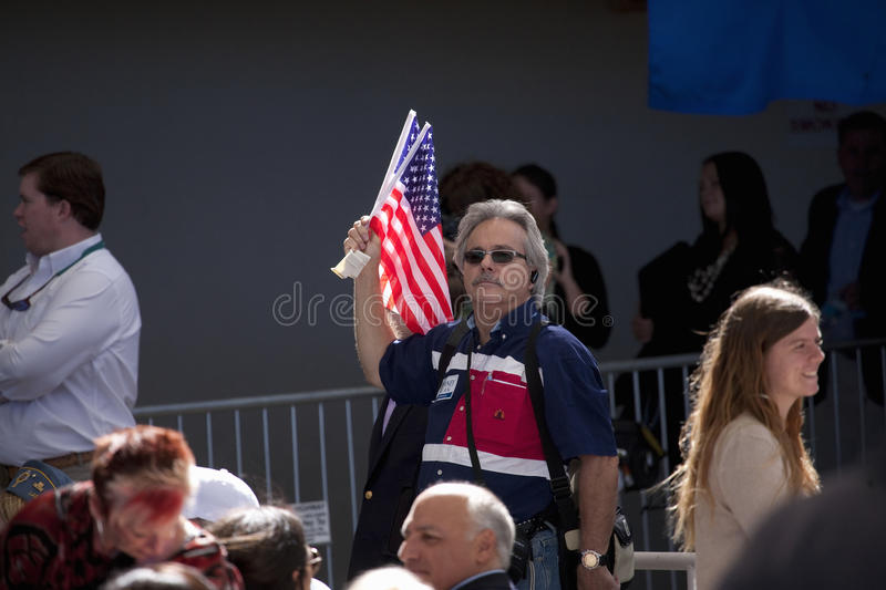 Supporter with US Flag for Governor Mitt Romney stock image