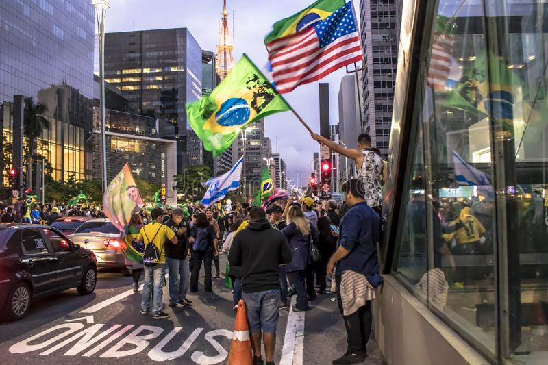 Supporters celebrate Bolsonaro victory in São Paulo - Supporters of President-elect Jair Bolsonaro celebrate the candidate`s vict. São Paulo, Brazil stock photography