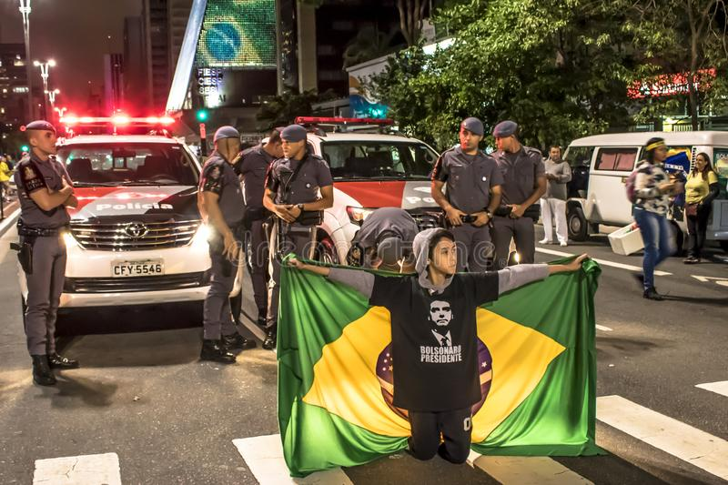 Supporters celebrate Bolsonaro victory in São Paulo - Supporters of President-elect Jair Bolsonaro c. São Paulo, Brazil, October 28, 2018. Supporters stock image