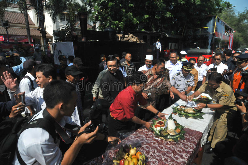 Supporters celebrate the victory of presidential candidate jokowi. Residents held a prayer and eat together as a form of gratitude victory Joko Widodo stock photo