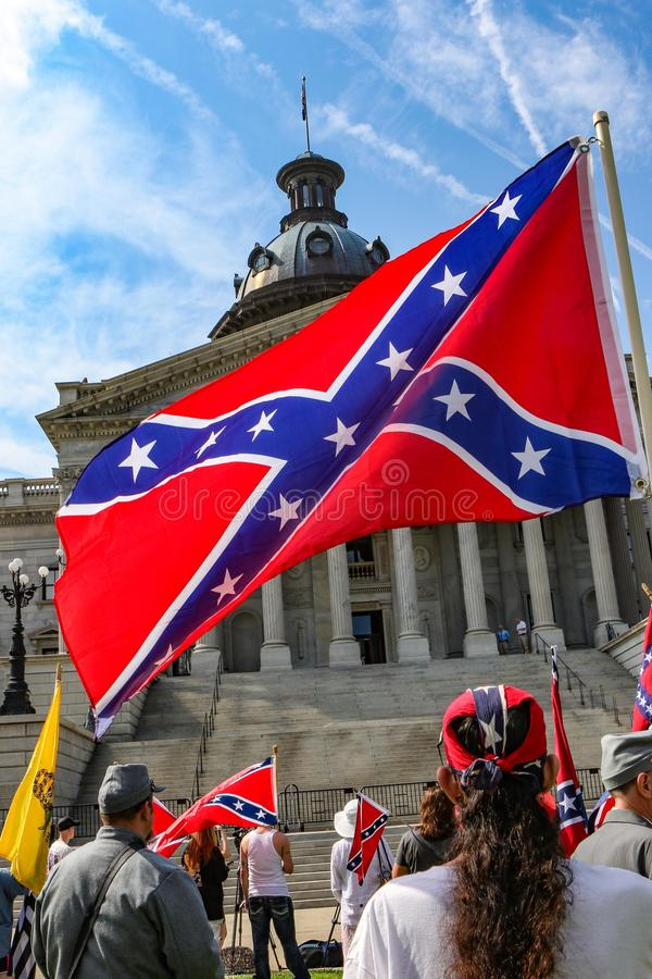 Supporters of the Confederate Flag. Supporters of flying the Confederate Flag gather at the South Carolina State House near the Confederate Soldier monument royalty free stock photo