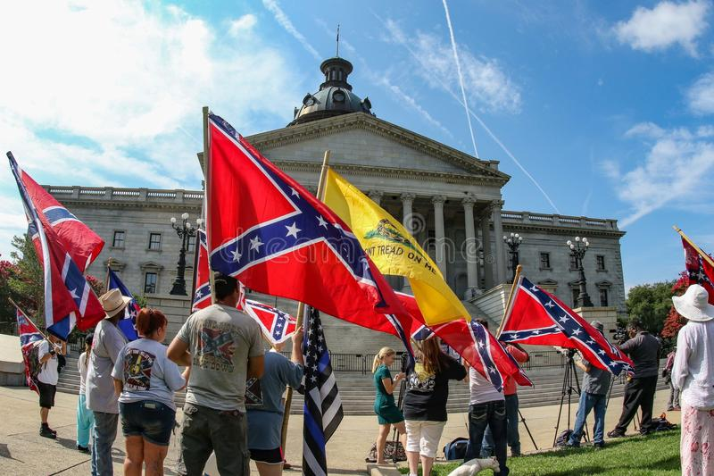 Supporters of the Confederate Flag. Supporters of flying the Confederate Flag gather at the South Carolina State House near the Confederate Soldier monument stock photo