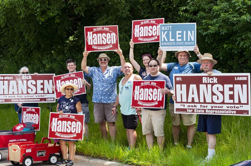 Supporters Hold Signs with Rick Hansen at Mendota Parade. Mendota, Minnesota/USA - July 13, 2019: Members of Minnesota Democratic Farmer Labor Party from Senate stock photography