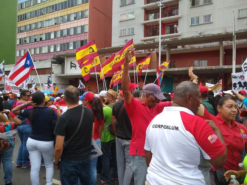 Supporters of Nicolas Maduro march in Caracas to  commemorate the first anniversary of reelection stock photo