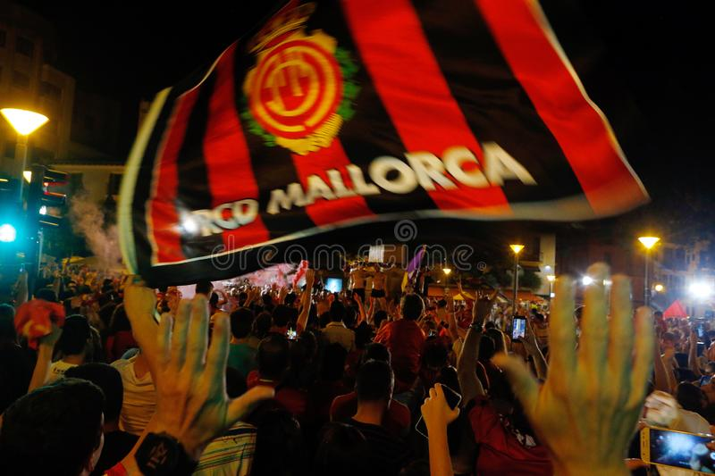 Supporters of Real Mallorca soccer team celebrating team promotion to top division downtown Palma royalty free stock photography