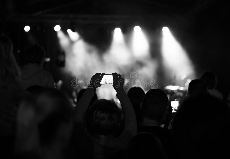 Supporters recording at concert, black and white, noise. Supporters recording at live concert, black and white, noise royalty free stock photos