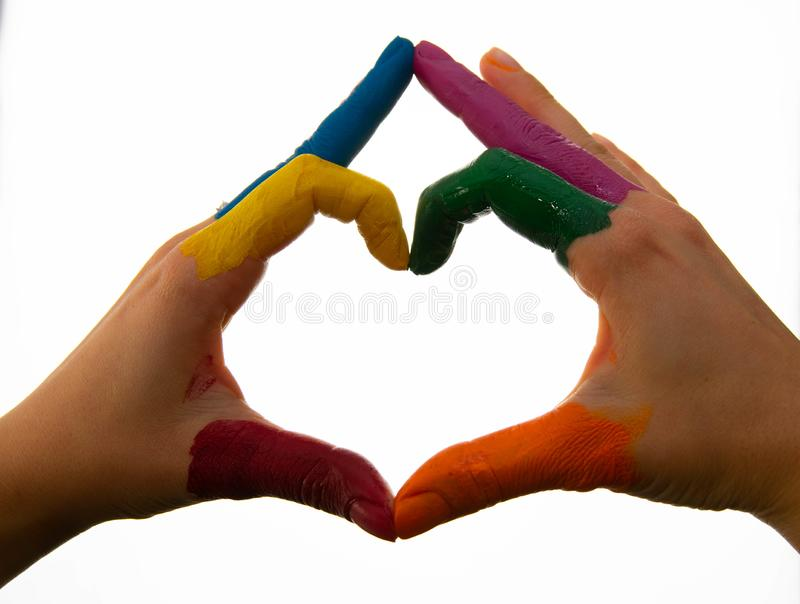 Supporting hands make a heat sign showing homosexuality colours. Heart shape with his hands royalty free stock photography