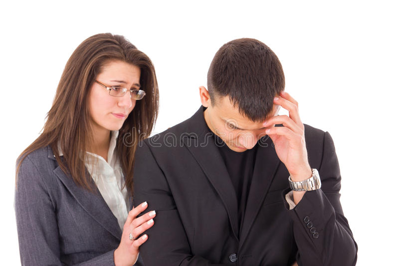 Supporting woman consoling sad man royalty free stock images