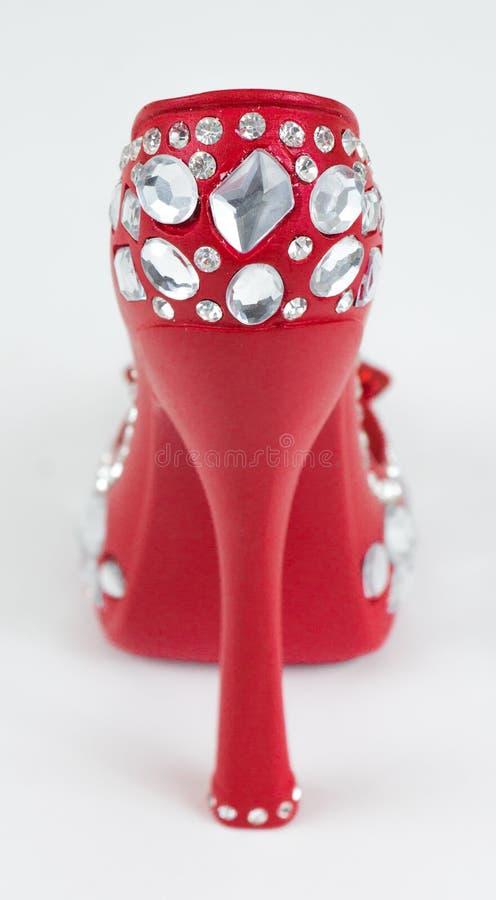 Supporto per gli anelli sotto forma di scarpe fotografia stock