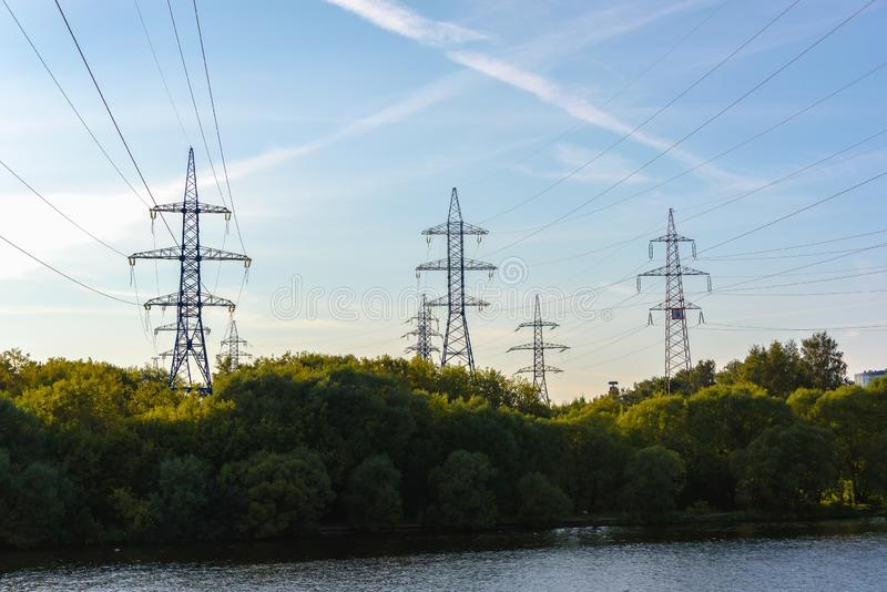 Supports of high-voltage transmission line. The transfer of energy. The provision of electricity royalty free stock images