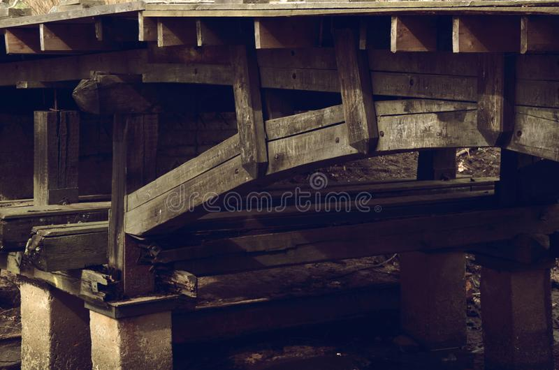 Supports of old wooden bridge. Supports of the old wooden bridge royalty free stock photos