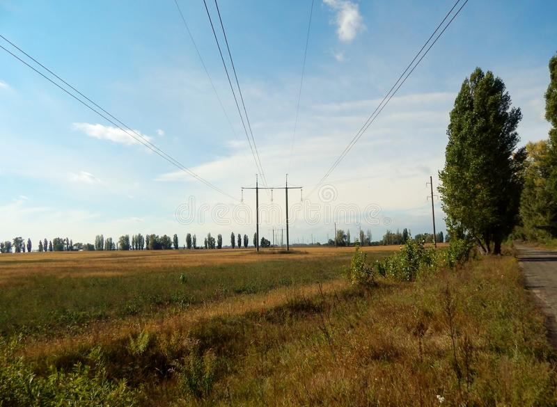 Supports of tl of energy. Supports of high-voltage line, that passes on the fields, forests, retain copper wires the current of high tension flows on that royalty free stock images