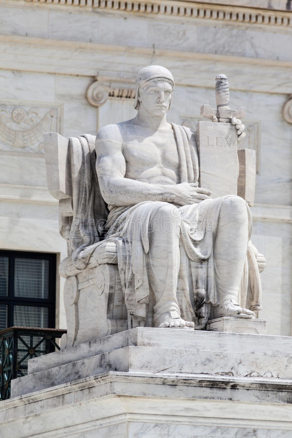 Supreme Court of the United States. Detail of the facade of the Supreme court of the United states. A marble sitting male statue. Washington, District of stock photos
